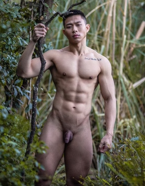 Hunky nude guy outdoors