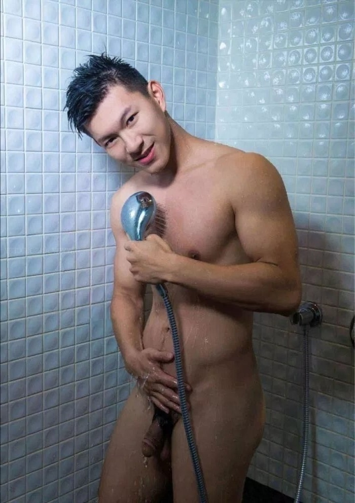 Shower boy with a soft cock
